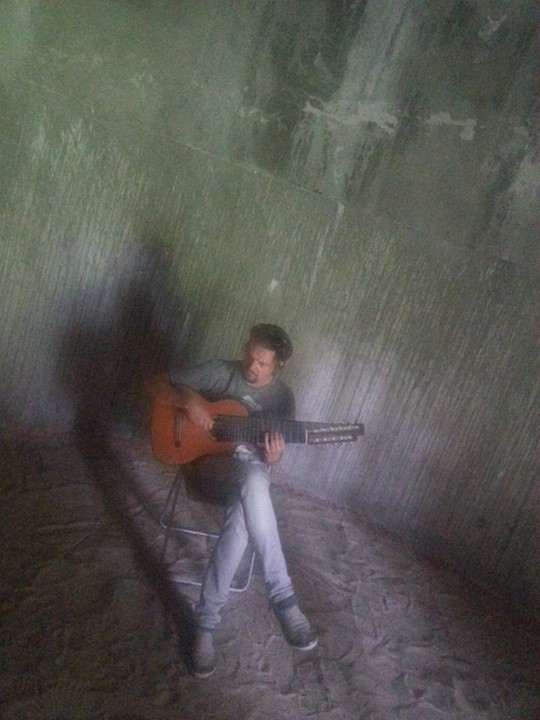 playing the 11-string alto guitar in a silo at Art OMI, NY